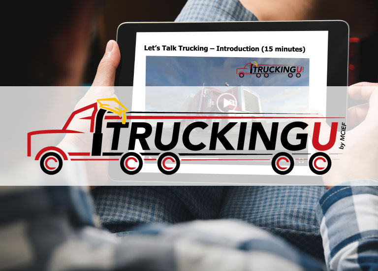 Trucking U logo with background of man holding a laptop while doing thumb ups sign